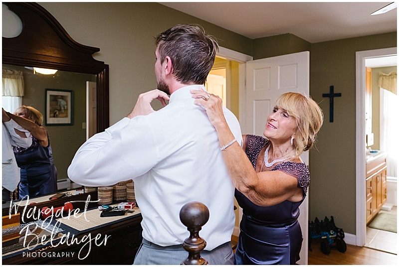 Mom adjusting her son's collar as he gets ready for his Bittersweet Farm wedding