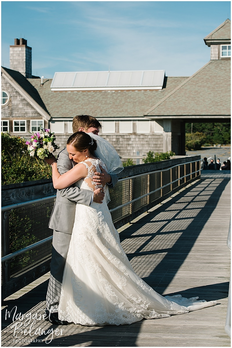 Bride and Groom embrace at their First Look at Horseneck Beach