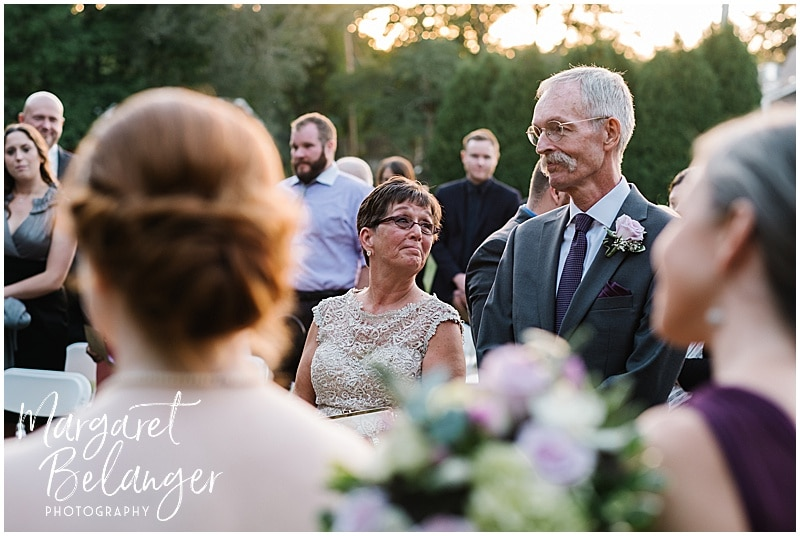 Bride's mom gazes at her husband at a Bittersweet Farm wedding