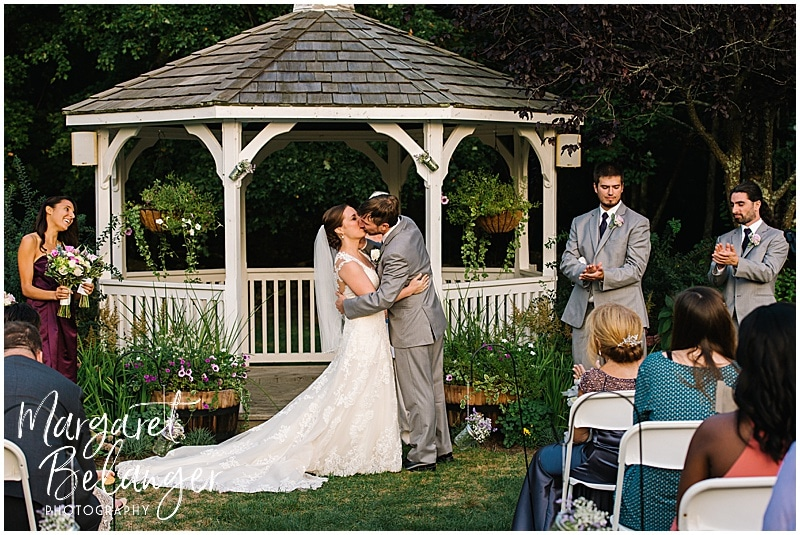 First Kiss as husband and wife at a Bittersweet Farm wedding ceremony