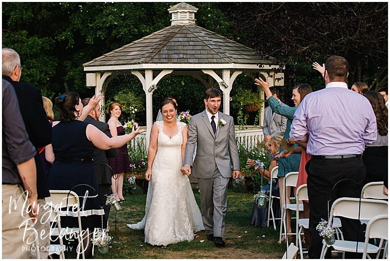 Newly married couple walk back down the aisle at a Bittersweet Farm wedding