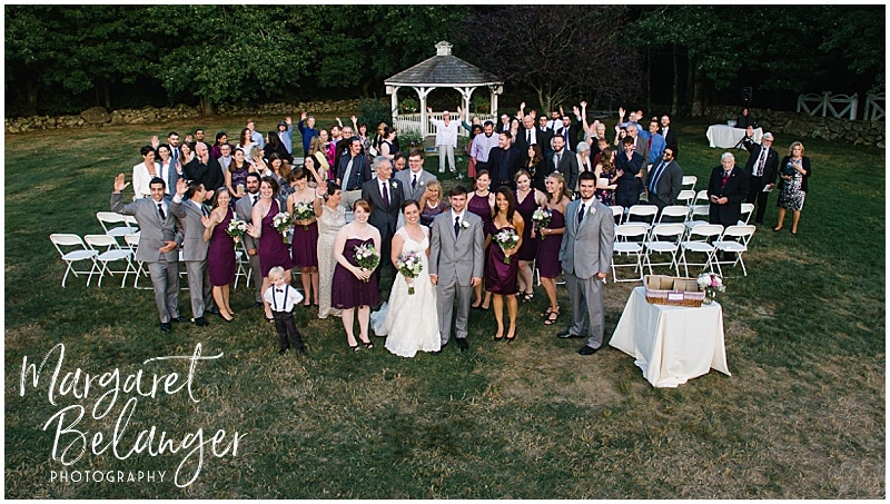 Drone shot of bride & groom and their wedding guests at the end of their wedding ceremony at Bittersweet Farm