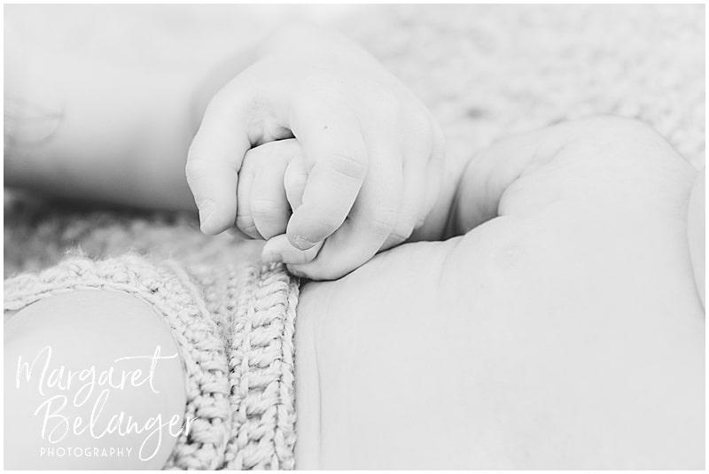 Brookline newborn session, big sister holding baby's hand
