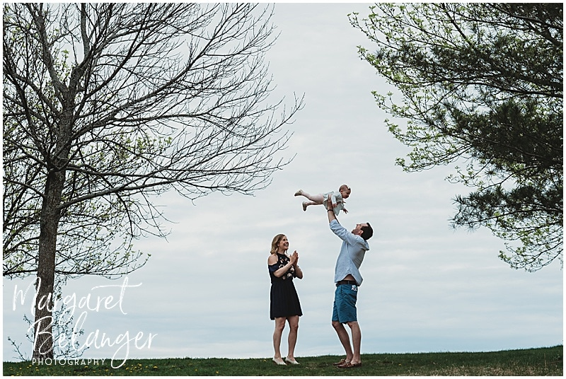 Cambridge family session, parents holding baby up
