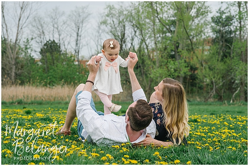 Cambridge family session, family photos lying down in the grass with dandelions