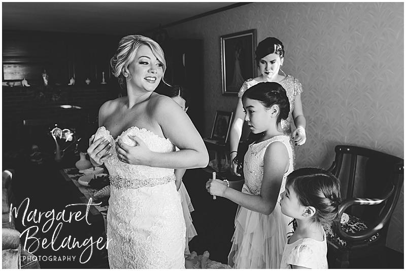 Winter wedding bride getting her dress on