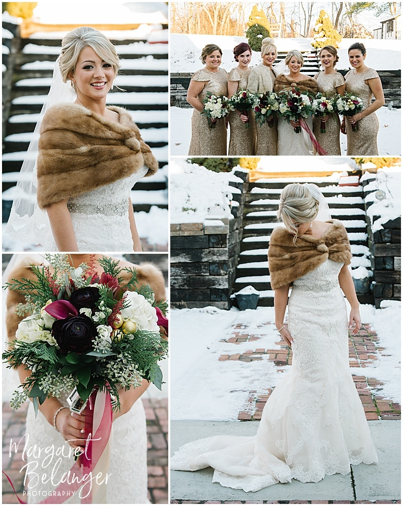 Bride in a fur stole poses for portraits outside in the snow