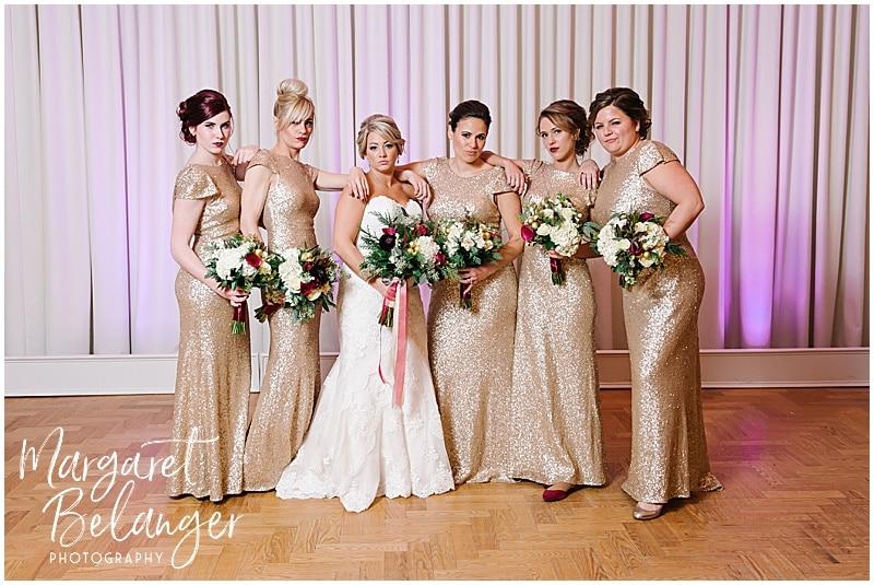Bride doing Bridesmaids badass pose with her bridesmaids