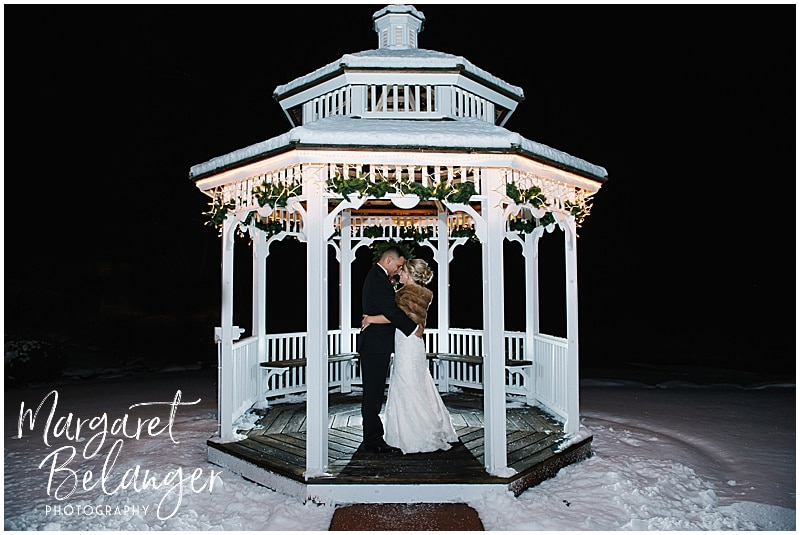 Nighttime winter portrait of Bride & Groom under the gazebo at Castleton, Windham, NH