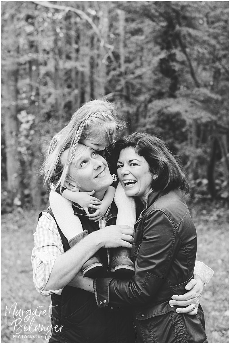 Little girl on dad's shoulders, hugging mom, at their Bradley Estate fall family session, Canton