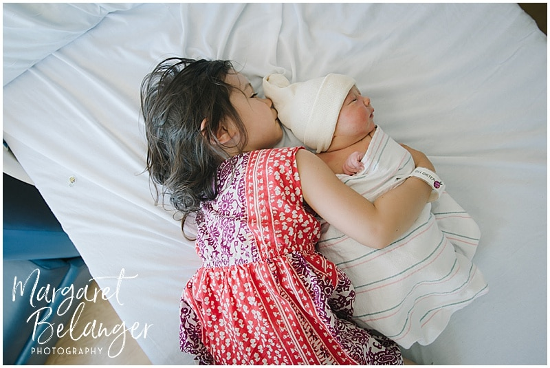Brigham and Women's Hospital Fresh 48 newborn session - big sister snuggling baby