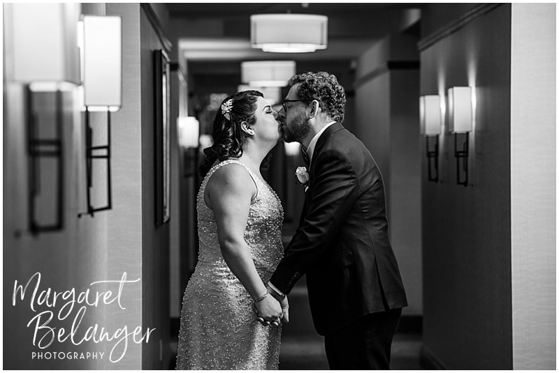 Black and white photo of the bride and groom kissing after their first look at the Ritz Carlton Boston