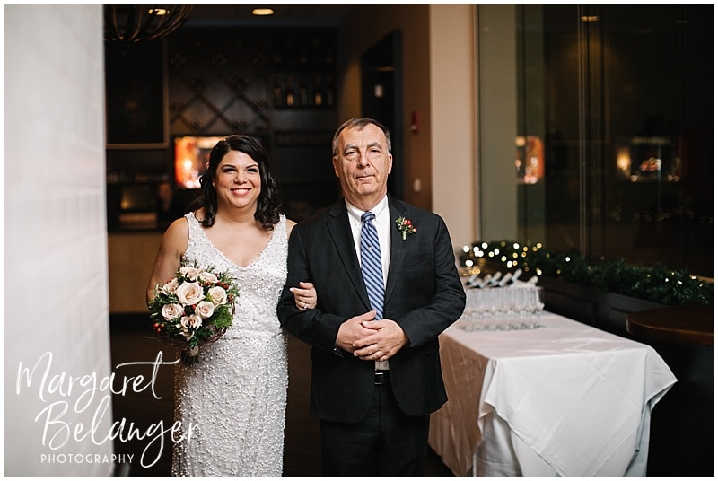 Bride and her father waiting to walk down the aisle at her intimate Boston restaurant wedding
