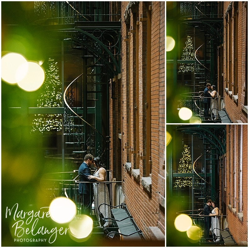 Portraits of bride & groom on a spiral staircase at an intimate Boston restaurant winter wedding reception