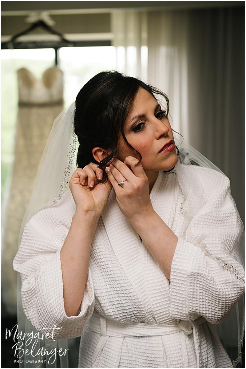 Rhode Island bride getting ready in front of wedding dress