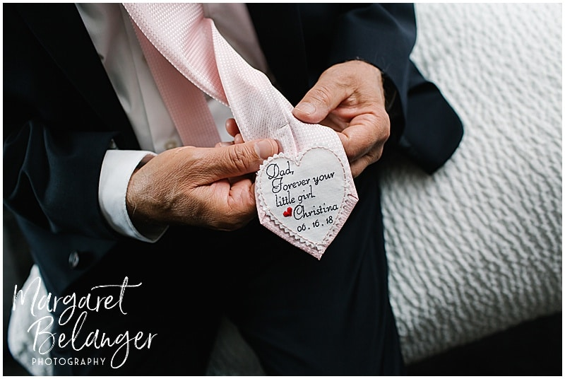 Stitched message on the back of the father of the bride's tie