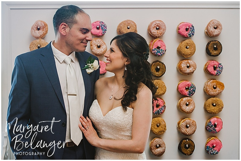 Kirkbrae Country Club wedding portrait of bride and groom in front of wall of Kane's donuts
