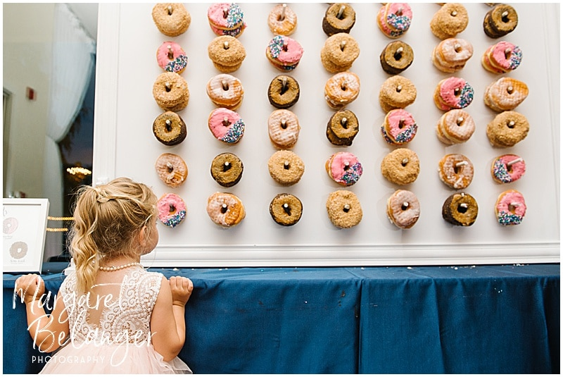 Kirkbrae Country Club wedding reception, flower girl with wall of Kane's donuts