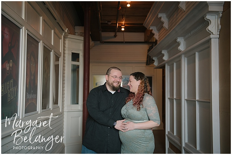 Mill No. 5 Lowell maternity session, parents in front of Luna Theater