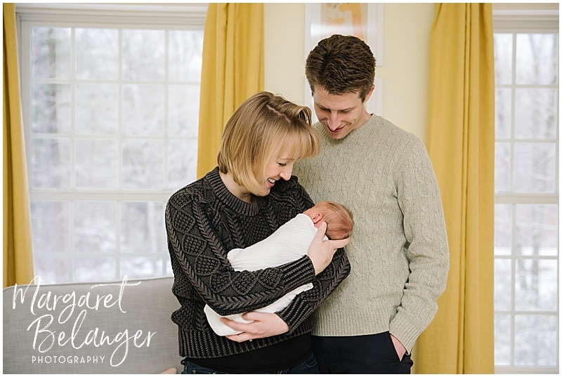 Parents holding their newborn in the nursery, New Hampshire newborn session
