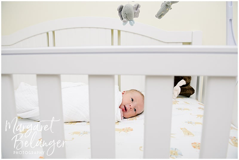 Newborn baby in her crib at her New Hampshire newborn session
