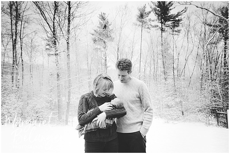 Parents hold baby outside in snow, New Hampshire newborn session