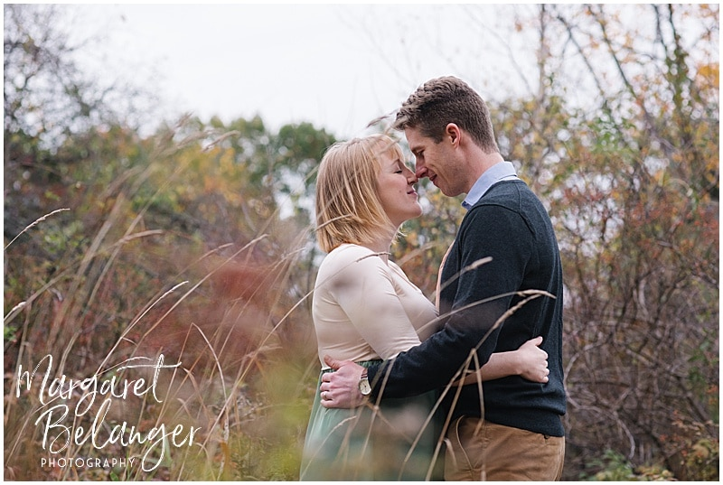 New Hampshire apple orchard autumn maternity session, couple touching noses