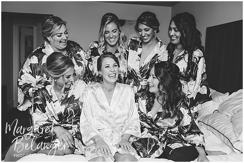 Newport wedding, bride and bridesmaids in their matching robes on the bed