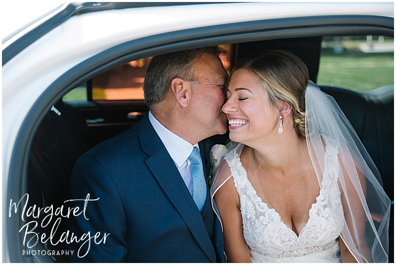 New Seabury Country Club wedding, father of bride kissing bride on the cheek in the limo