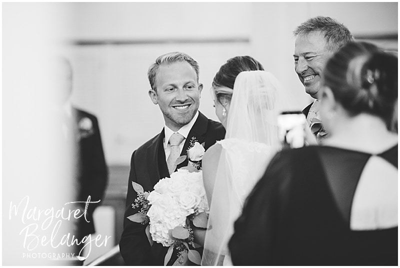 New Seabury Country Club wedding, groom greeting bride at the altar