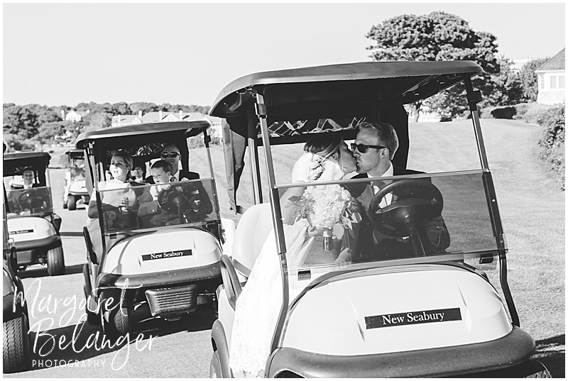 New Seabury Country Club wedding, bride and groom kiss in a golf cart