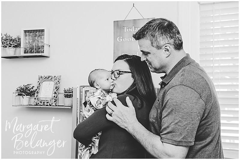 South Shore newborn session, baby with parents in her pink nursery