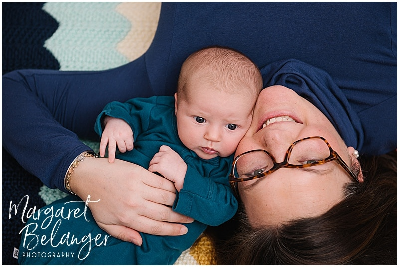 South Shore newborn session, mom and baby nestled together