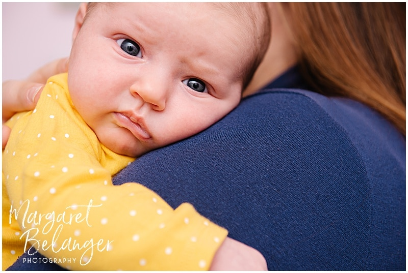 South Shore newborn session, close-up of baby's face on mom's shoulder