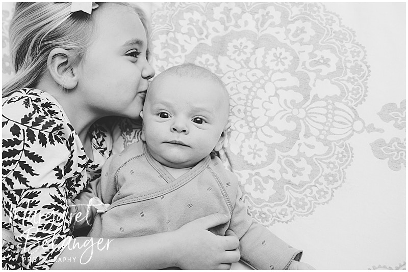Charlestown newborn session, sister kissing baby brother