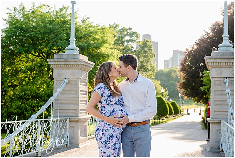 Sunrise Maternity session in the Boston Public Gardens, mom and dad kissing on bridge