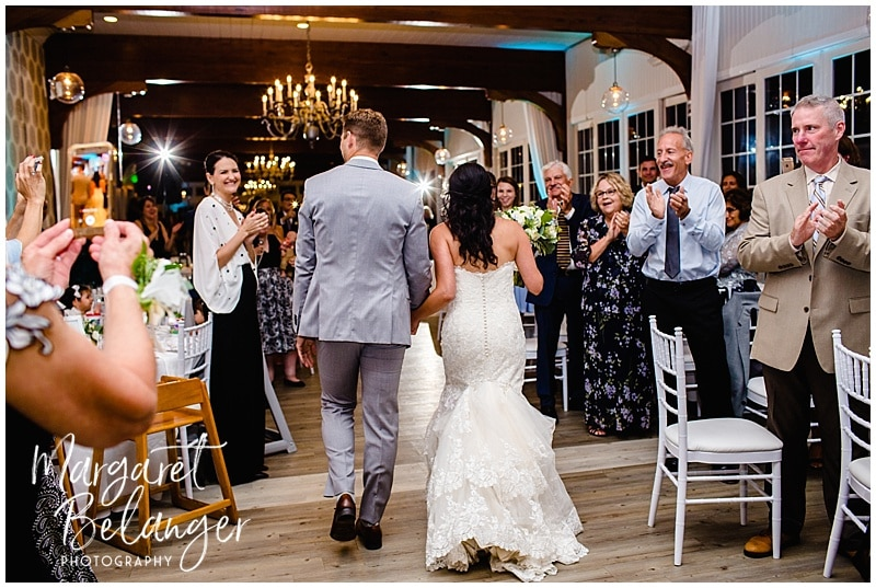 Bride and groom enter their wedding reception at the Wychmere Beach Club