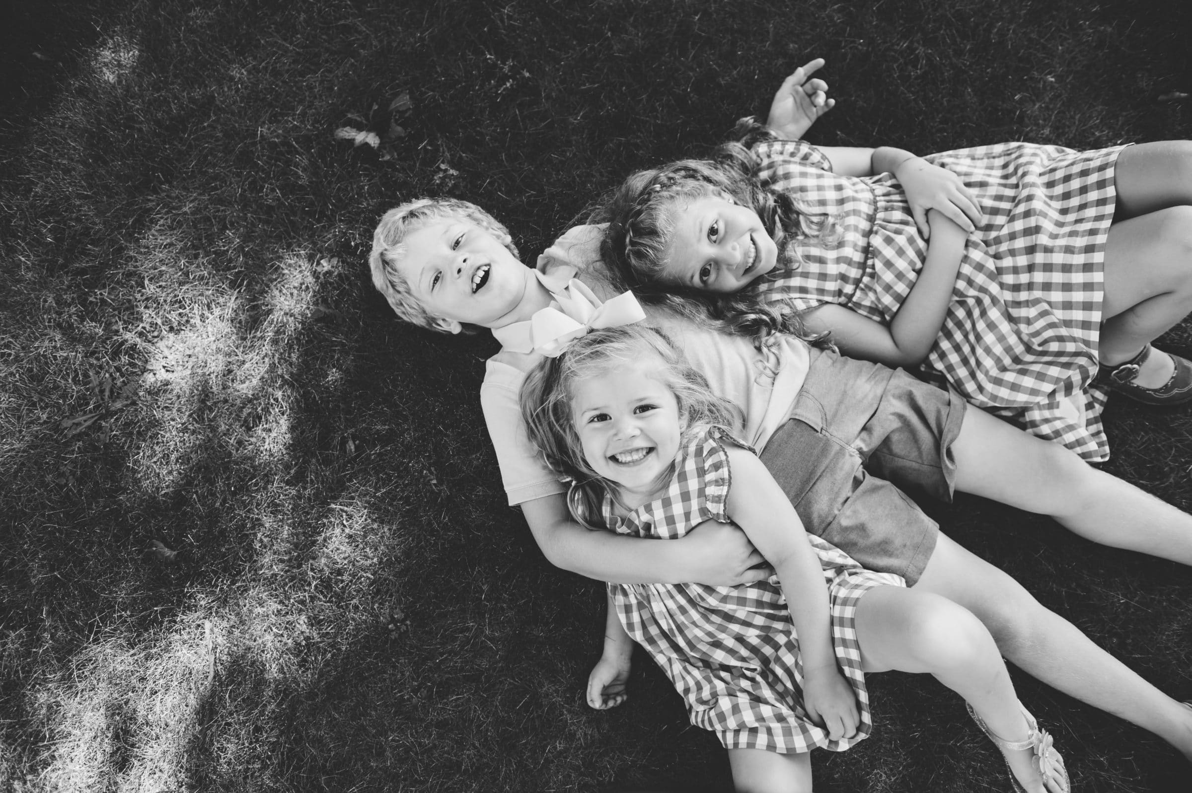 Cambridge family session, three children on the grass