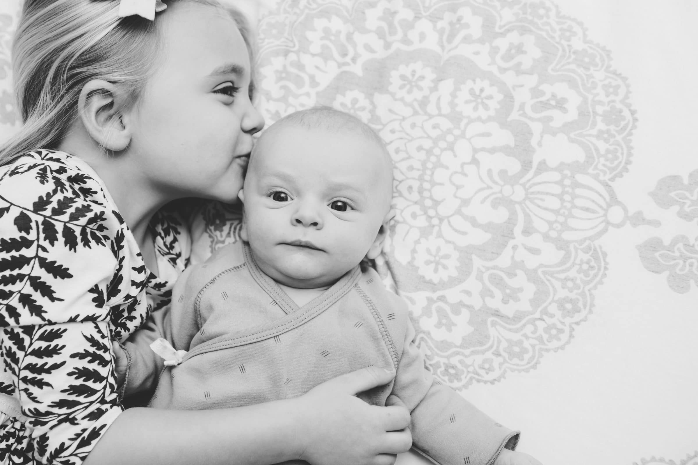Charlestown family session, sister kisses new brother