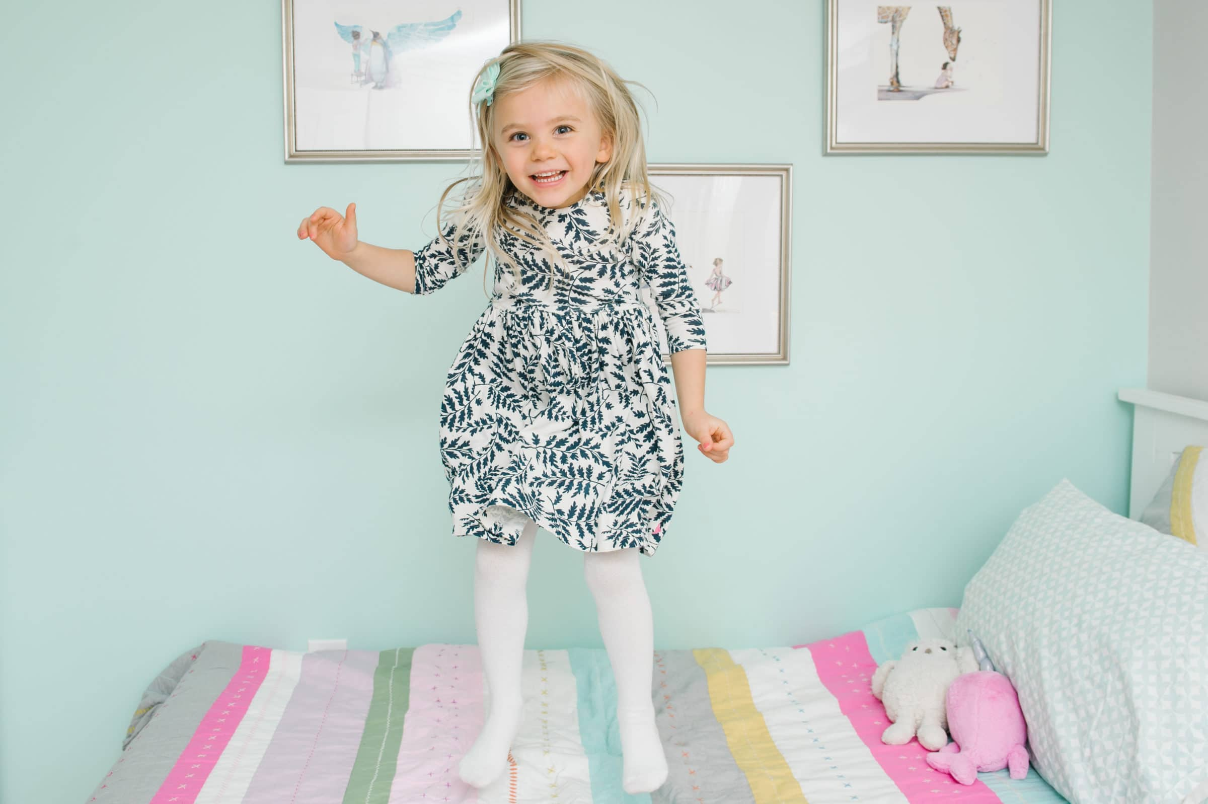 Charlestown Family Session, girl jumping on bed
