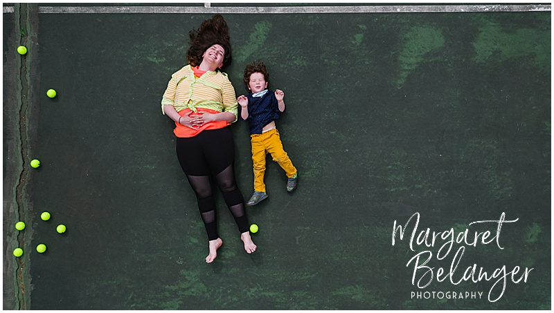 Drone portrait of a woman and a little boy on a tennis court