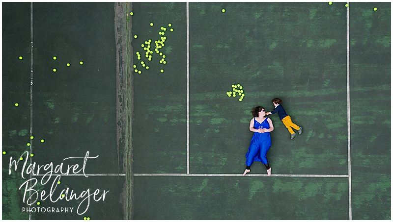 Drone portrait of a woman and a little boy floating on a tennis court